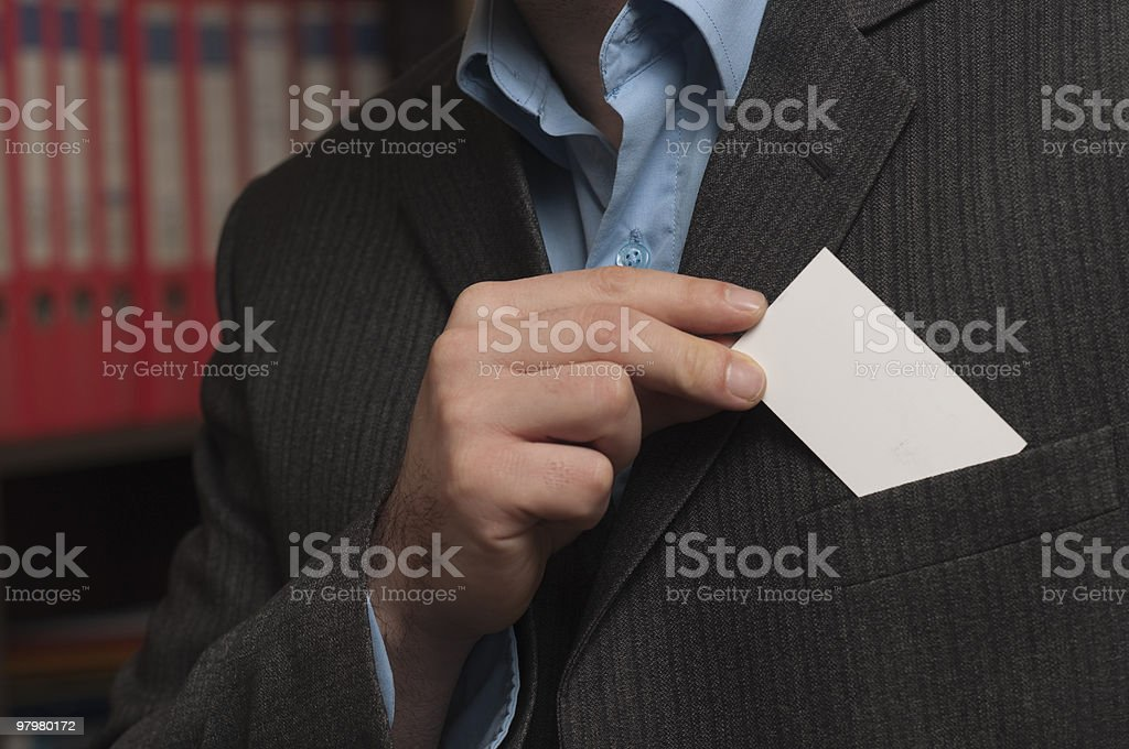 Вusinessman taking business card on a background of office royalty-free stock photo