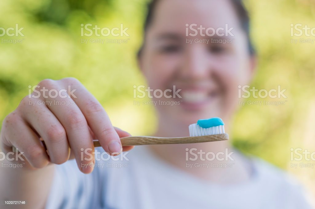 Using a Bamboo Toothbrush stock photo