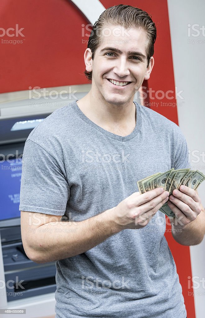 Using a bank ATM royalty-free stock photo