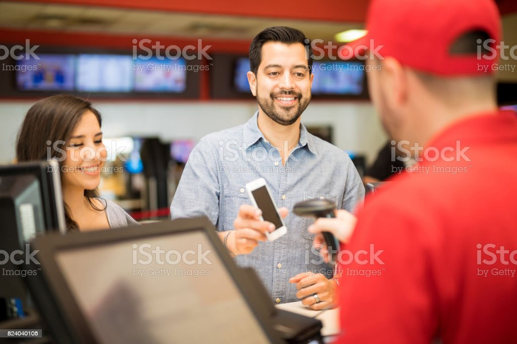 Using a barcode for tickets at the movies stock photo