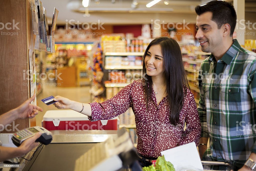 Using a credit card at the store stock photo
