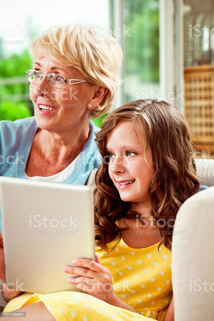 Using a digital tablet at home royalty-free stock photo