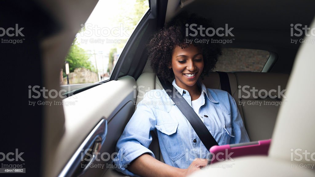 Using a Digital Tablet in a Taxi stock photo