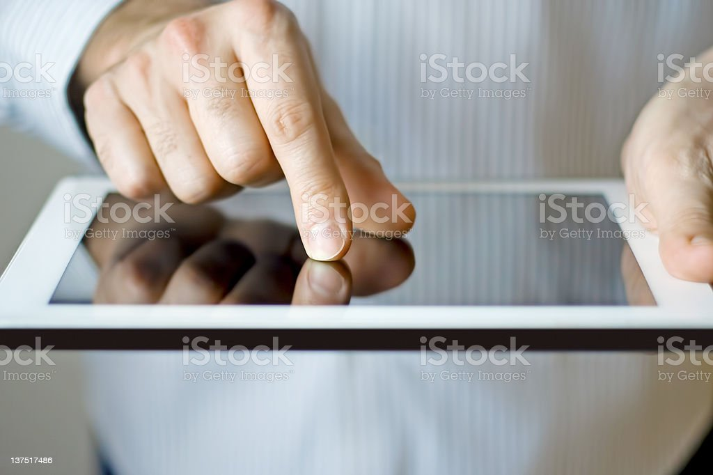 Using a digital tablet royalty-free stock photo