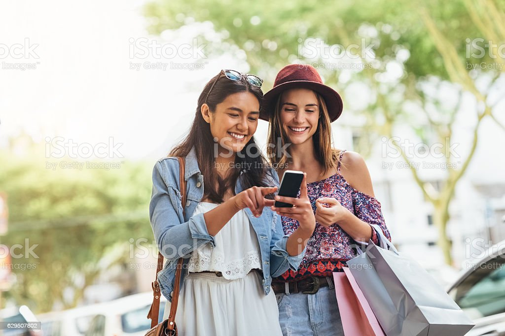 Using a great app to find great deals stock photo