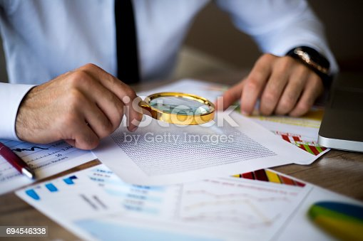 istock Using a magnifying glass 694546338