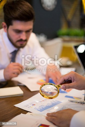 istock Using a magnifying glass 952859226