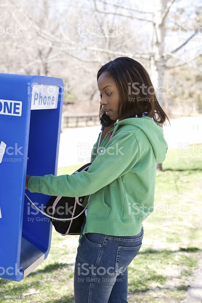 Using a Pay Phone royalty-free stock photo
