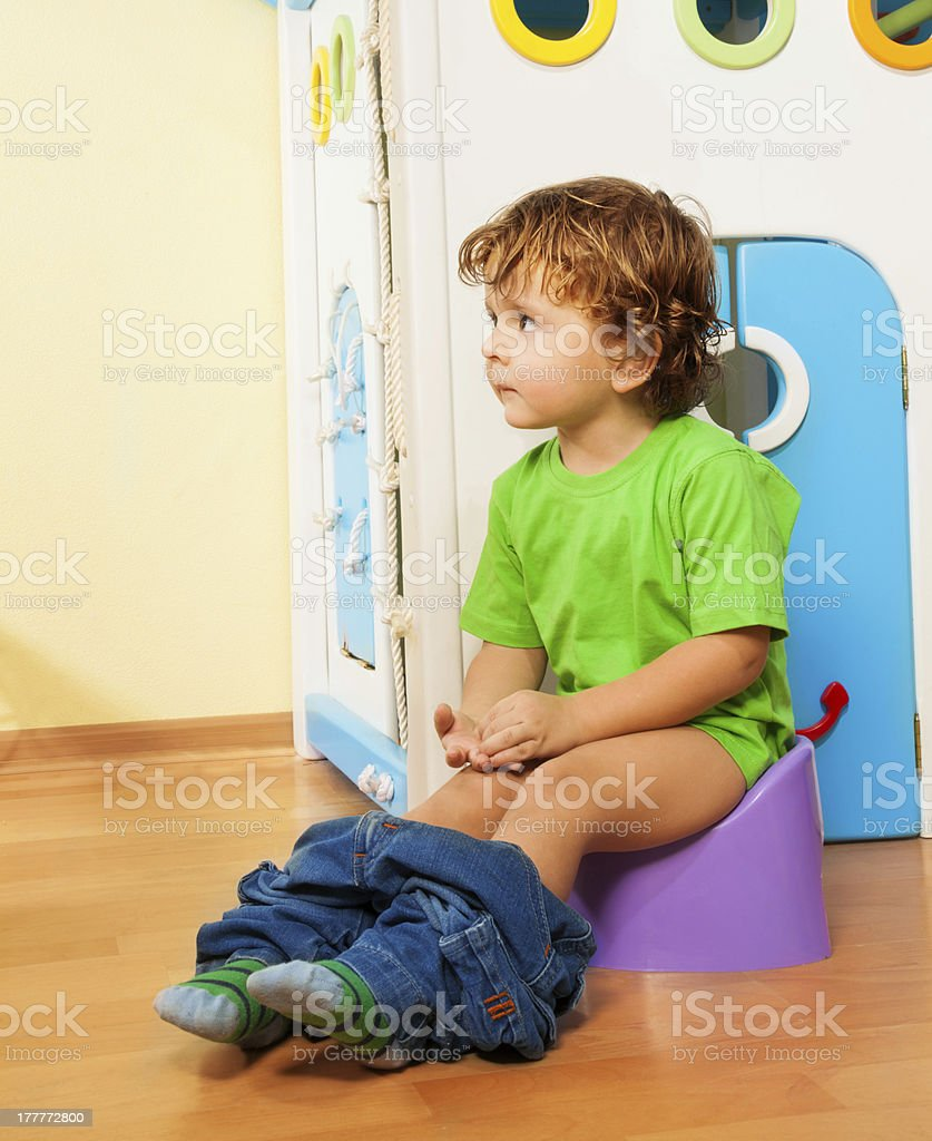 Using a potty stock photo