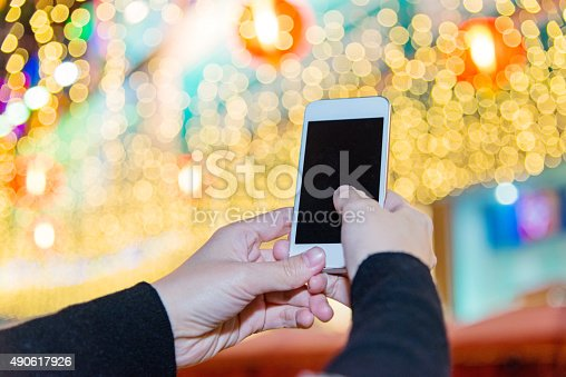istock using a smart phone at night 490617926