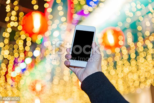 istock using a smart phone at night 490618102