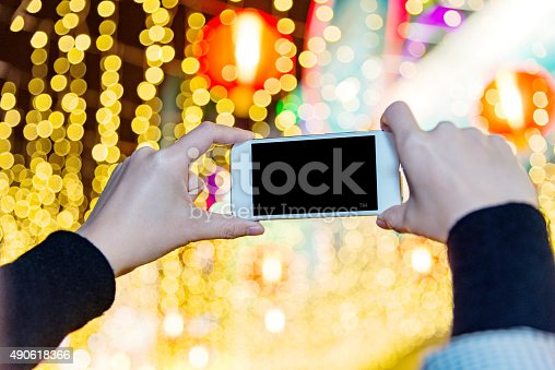 istock using a smart phone at night 490618366