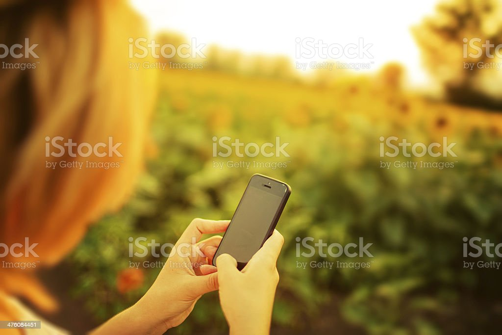 Using a smartphone outdoors royalty-free stock photo