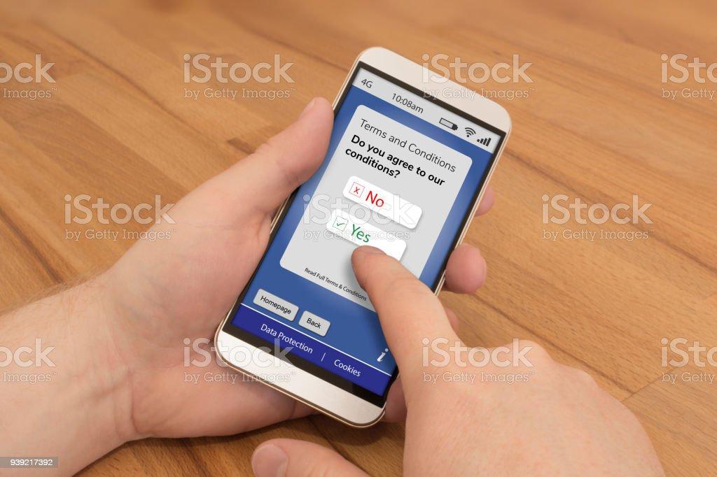 Met behulp van een smartphone te stemmen met de voorwaarden en bepalingen foto