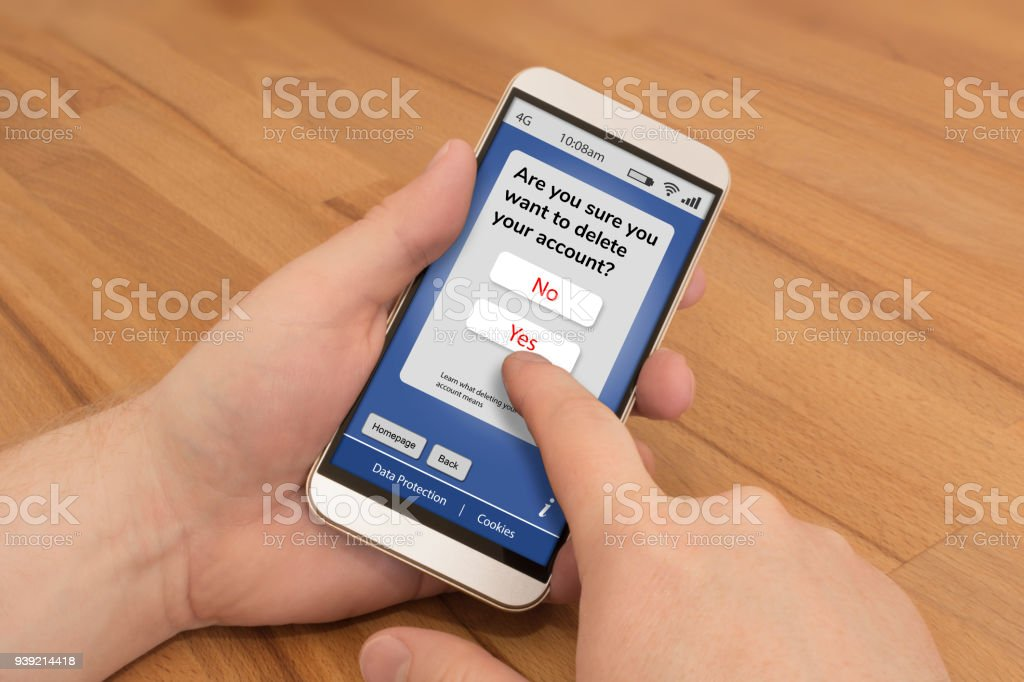 Using a smartphone to delete an online account stock photo