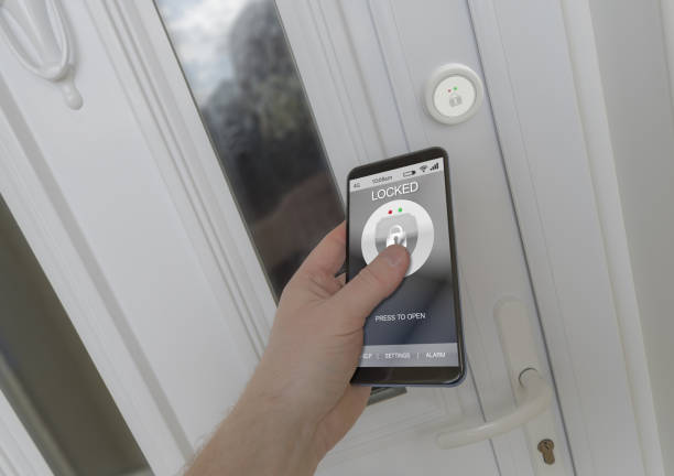 Using a smartphone to open an electronic lock on a front door Using a smartphone to open a smart lock on a front door home automation stock pictures, royalty-free photos & images