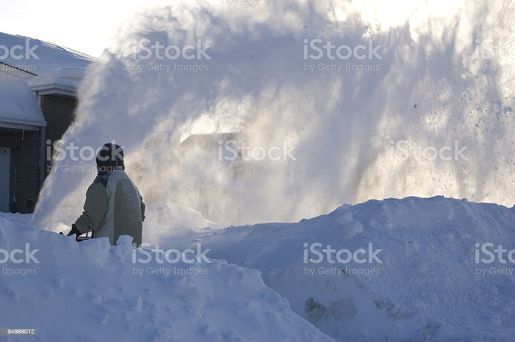 Using a snowblower stock photo