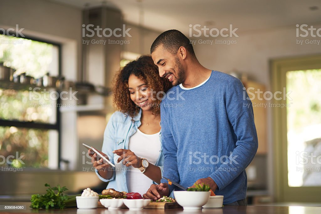 Using a step by step online recipe stock photo