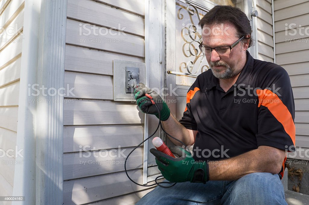 Using A Tester On Outside House Outlet stock photo