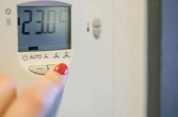 Using a thermostat stock photo