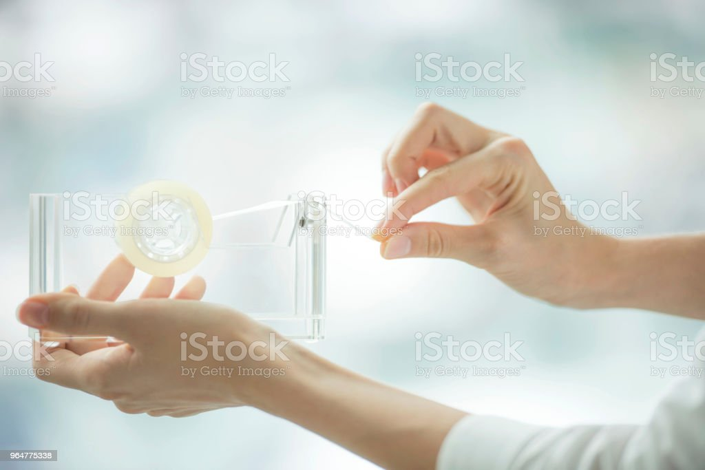 Using adhesive tape royalty-free stock photo