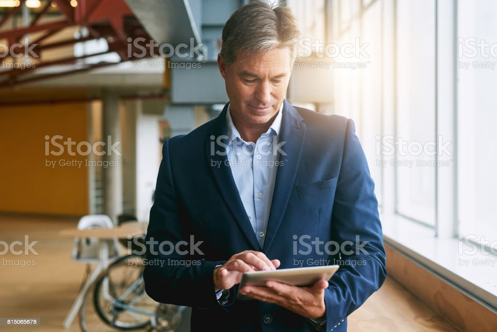 Using all the latest apps to help manage his business stock photo