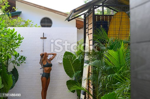 Having a rinse in an outdoor shower after swimming in the sea