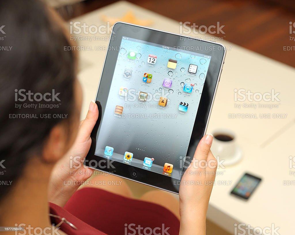 Using Apple iPad royalty-free stock photo