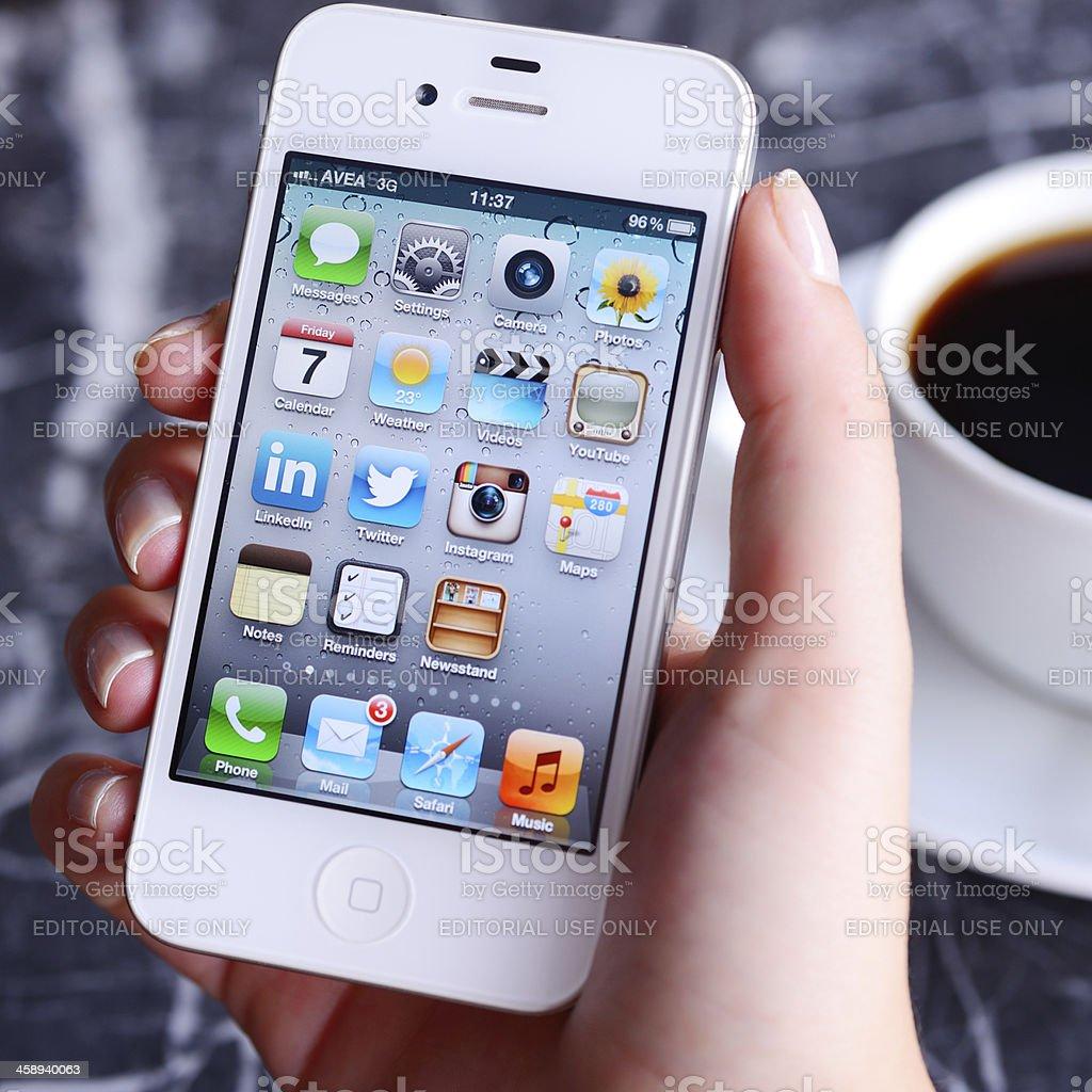 using Apple iPhone 4 royalty-free stock photo