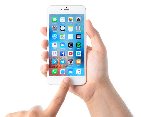 istock Using Apple iPhone 6 plus 523239142