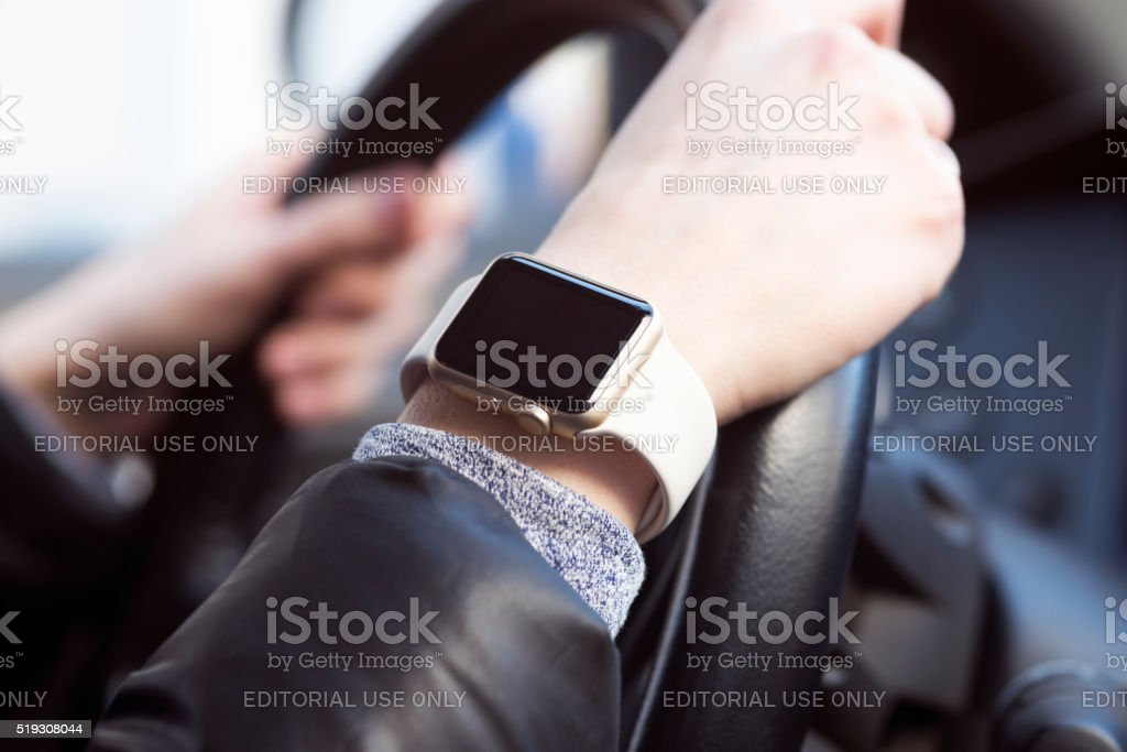 Using Apple Watch in car stock photo