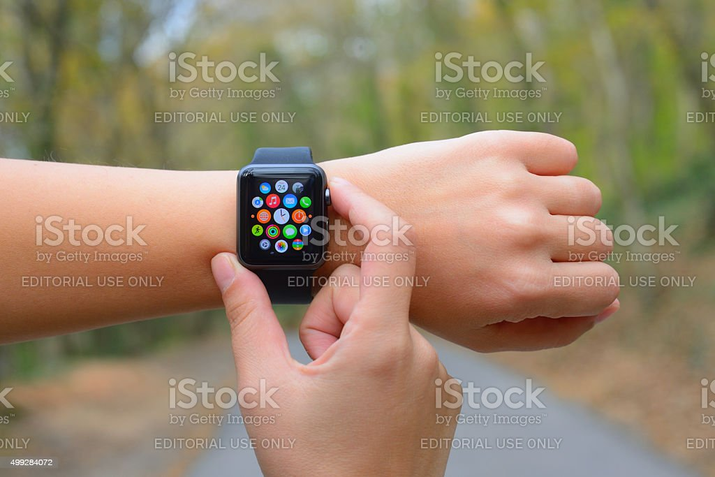 Using Apple Watch in nature stock photo