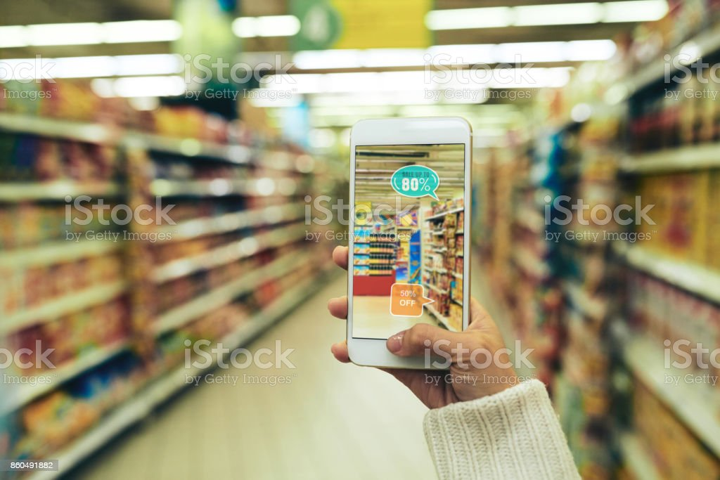 Using Augmented Reality App at Supermarket stock photo