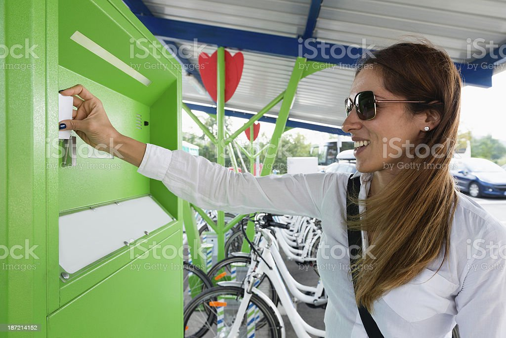 Using bicycle sharing system royalty-free stock photo