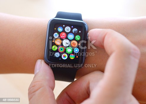 İstanbul, Turkey - July 16 2015: Hand touching an Apple Watch displaying home screen. Apple Watch is a smart watch, devices developed by Apple Inc.
