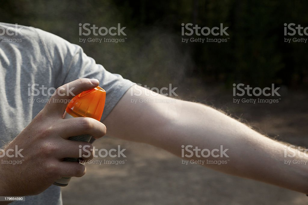 Using Bug Spray stock photo