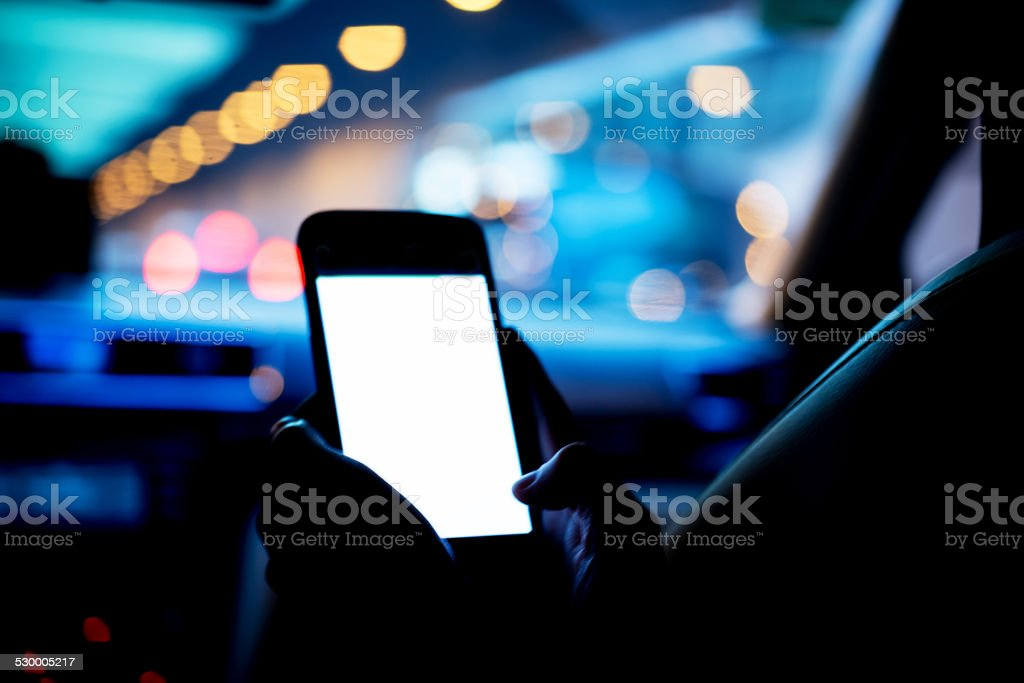 using cell phone in a car stock photo