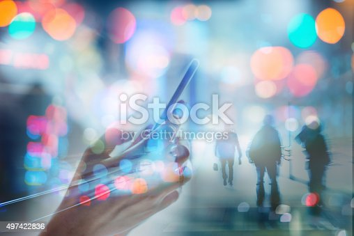 Cell phone in hand with modern abstract city and walking people abstract background, double exposure.