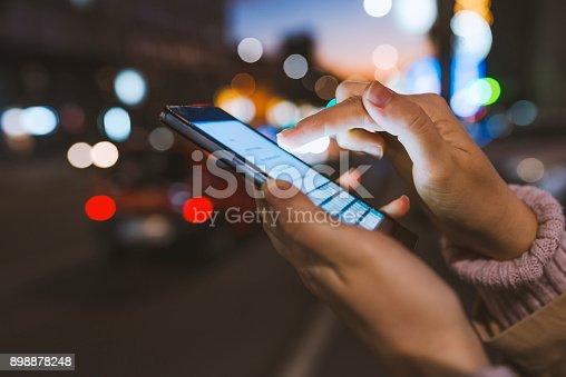 istock Using cellphone at night 898878248