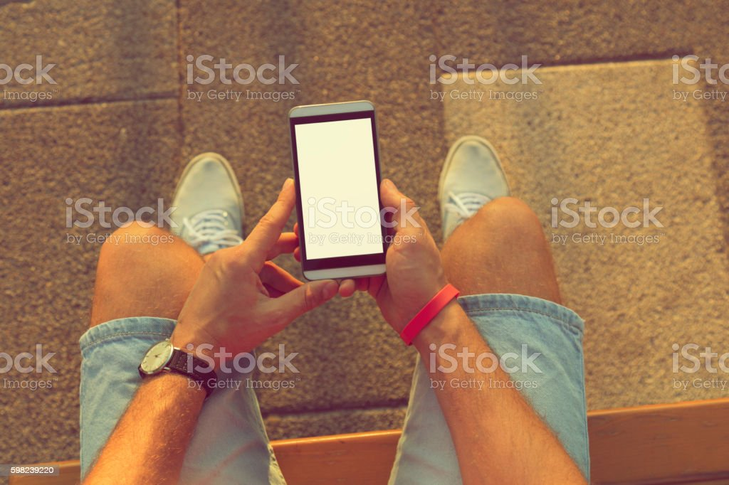 Using cellphone outdoors. stock photo