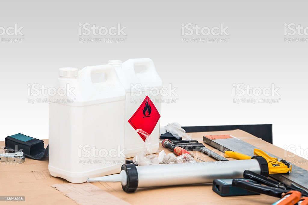 Using chemicals in canister during construction process stock photo