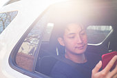istock Using digital device in the car 1197750154