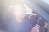 istock Using digital device in the car 1197750172