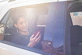 istock Using digital device in the car 1197750194