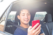 istock Using digital device in the car 1197750778