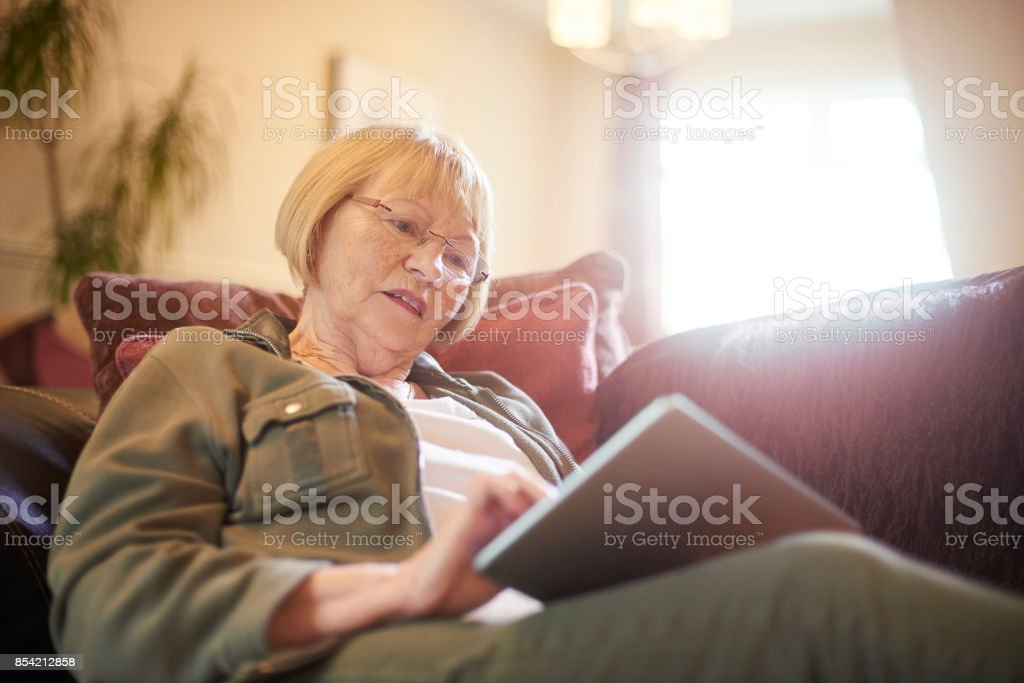 Using digital tablet at home stock photo