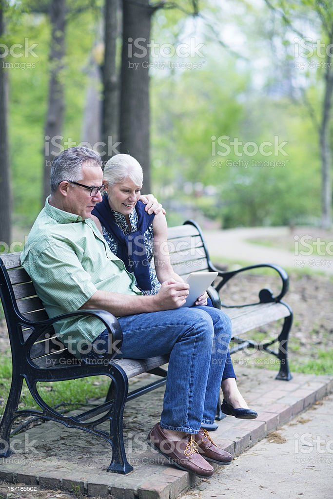 Using digital tablet in the park royalty-free stock photo