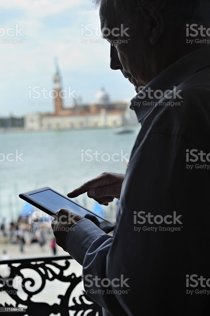 Using digital tablet in Venice royalty-free stock photo