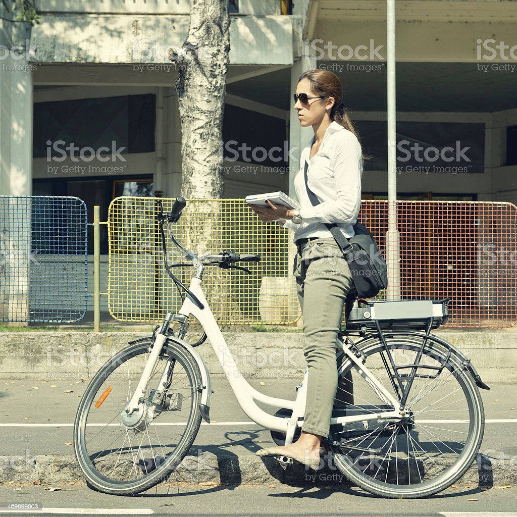 Using e-bike to get to work stock photo