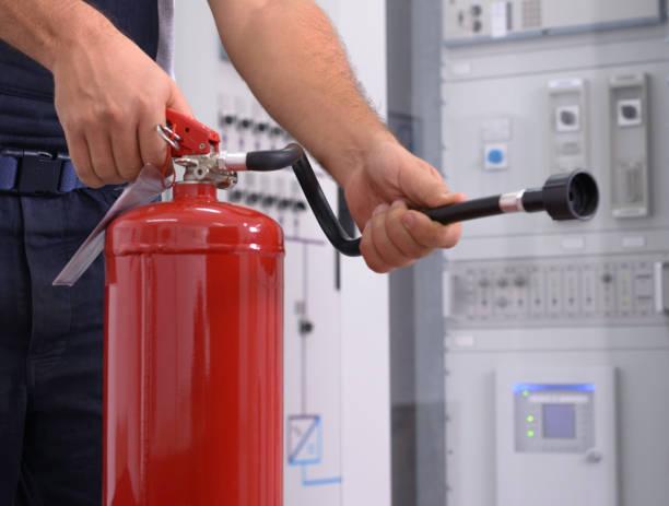 Using fire extinguisher stock photo